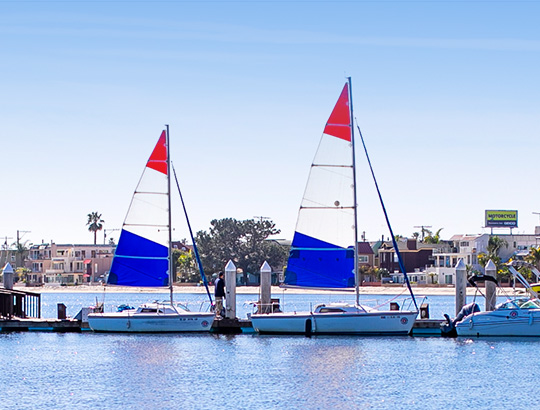 A pair of sailboat docked at the Catamaran on Mission Bay