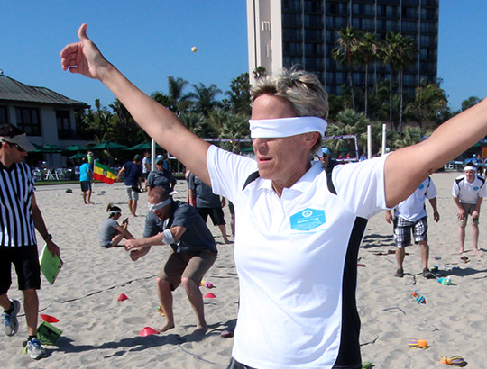 Woman with arms open wide playing sand games