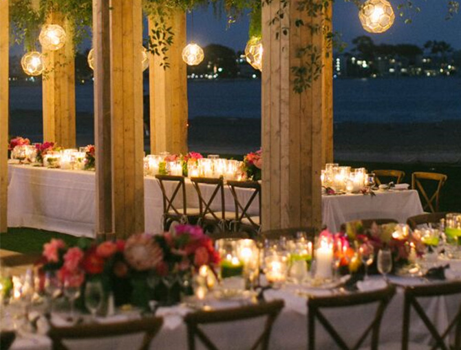 Rustic looking table setting at a rehearsal dinner overlooking Mission Bay