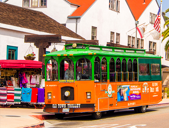Old Town Trolley making a stop at Old Town San Diego on the hop on and off tour