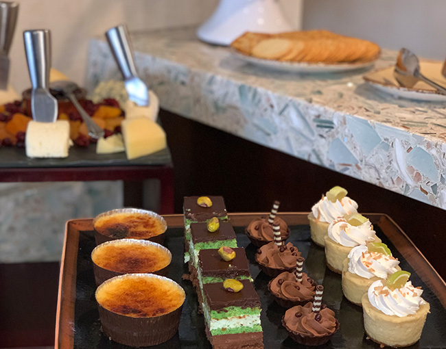 An assortment of desserts and cheeses