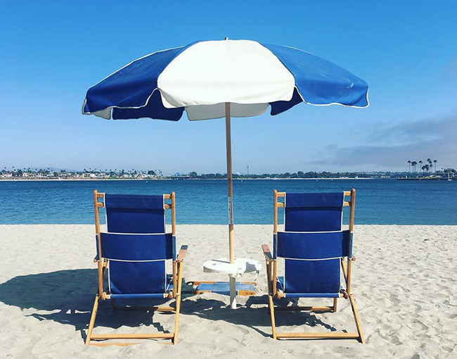 Beach chairs and umbrella overlooking Mission Bay