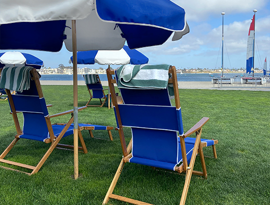 Beach chairs and umbrellas overlooking Mission Bay