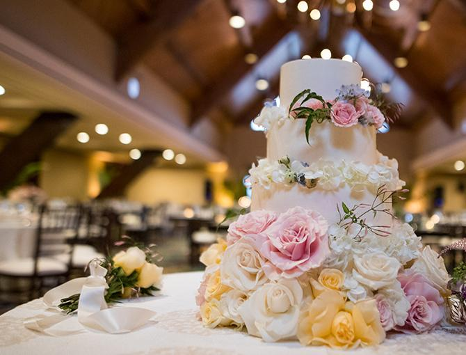 Four tier wedding cake with flowers, at the Kon Tiki Ballroom, the Catamaran Resort