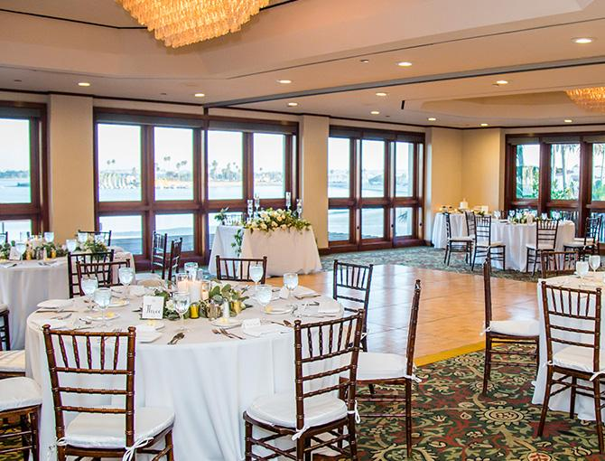 Catamaran Resort's wedding reception in the Boardroom with bay views from the adjacent outdoor balcony.
